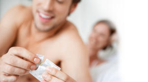 Man Holding Contraceptive for Happy Relationship and Intimacy
