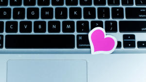 Dating World: Heart Shape on Laptop as Concept of Dating