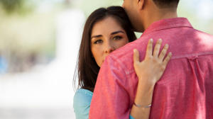 New Relationship With Romantic Couple Embracing